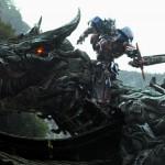 Optimus Prime riding a giant Dinosaur