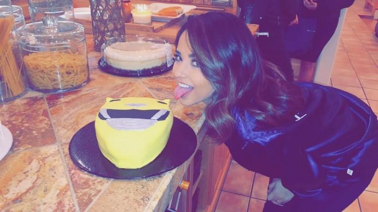 BEcky Gomez eating a Power Rangers cake